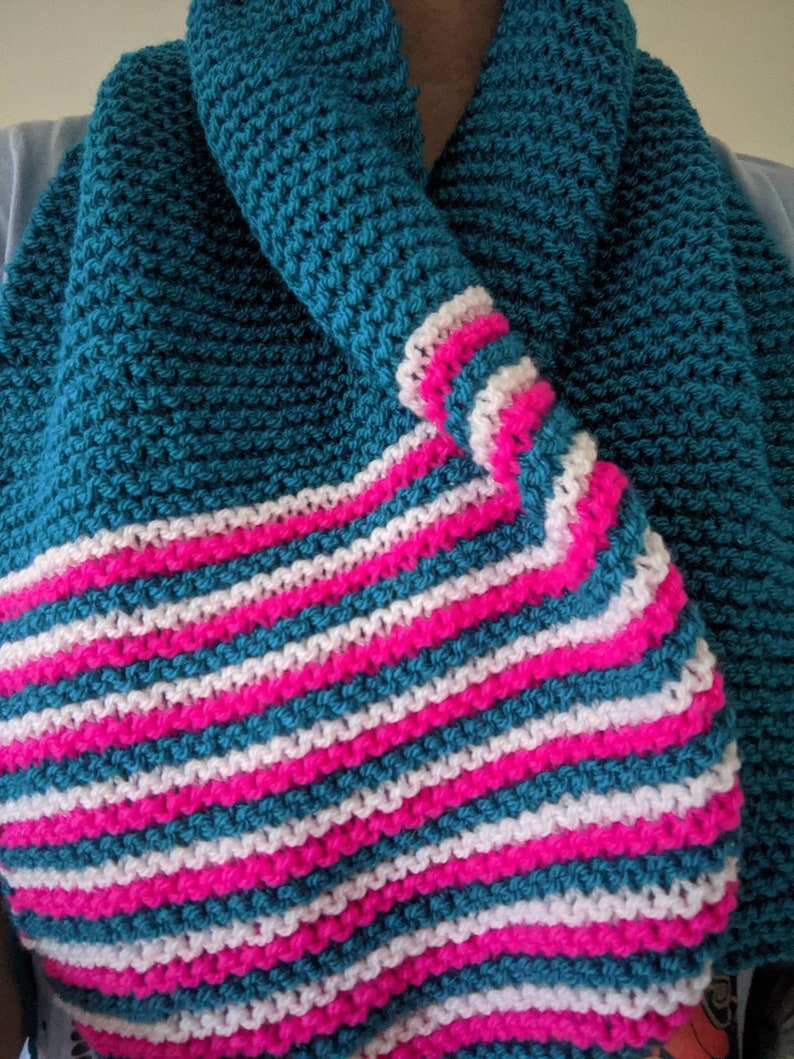 Hand knit scarf unisex vibrant colours to edge.