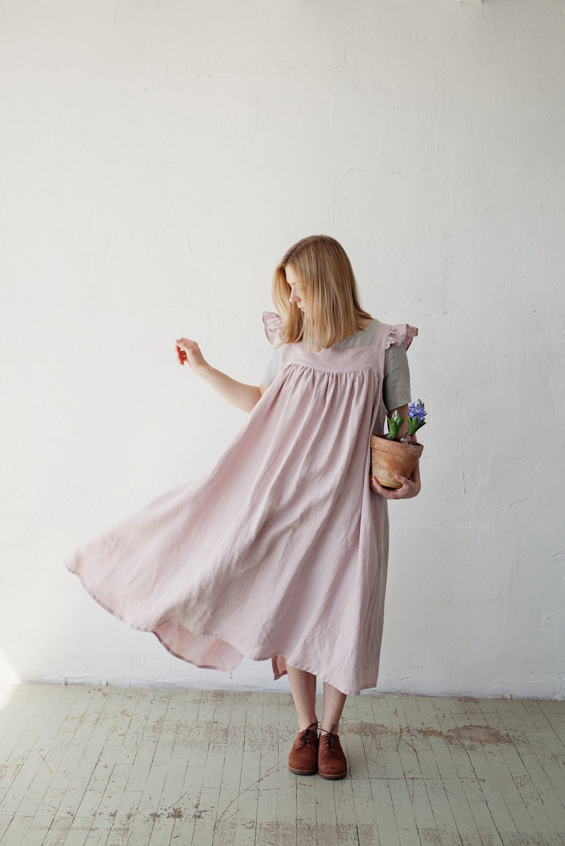 1920s Outfit Ideas: 10 Downton Abbey Inspired Costumes Linen Dress with Flutter Sleeves Oversized Apron Pink Linen Apron Linen Dress with Wings Victorian Style Pinafore $100.12 AT vintagedancer.com