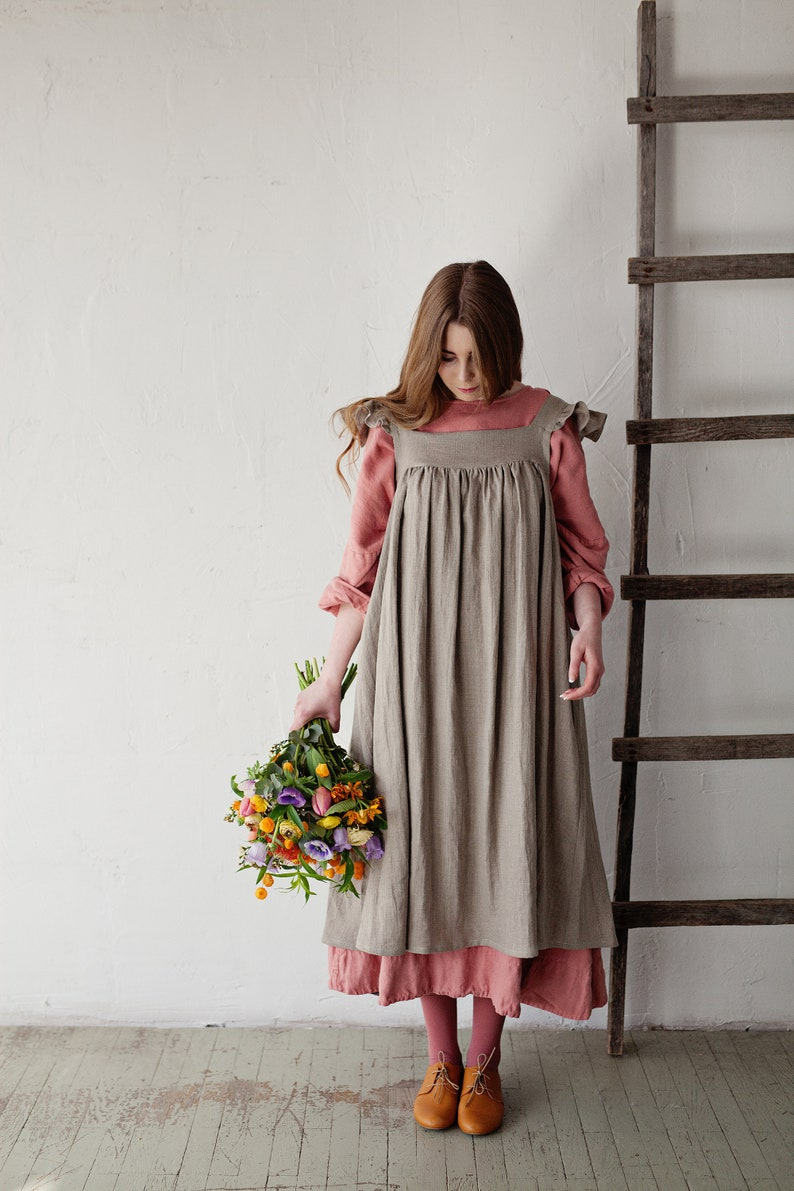 Cottagecore Clothing, Soft Aesthetic Linen Dress with Flutter Sleeve Oversized Apron Natural Linen Apron Linen Dress with Wings Ruffle Sleeve Apron Victorian Style Pinafore $103.56 AT vintagedancer.com