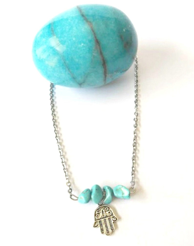 Stainless steel silver necklace with turquoise beads and the hamsa hand pendant