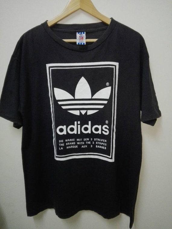 Vintage 90s ADIDAS Three Stripeswhite big logo big spellsportwearcrewneck tshirthip hop run DMCadidas trefoilblack coloursize M