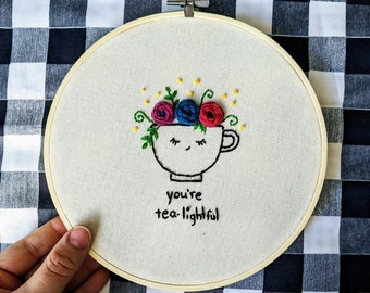"""Embroidered Hoop Art - """"You're tea-lightful"""" Smiling Blooming Teacup Flowers Floral Roses Embroidery Plant Art Word Play Glittering Yarn Pun"""