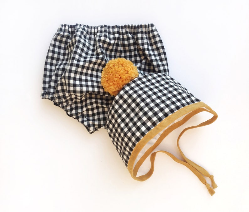 Autumn Winter Bonnets Black and White Gingham Bonnet with Mustard Binding and matching Pom Pom Baby and Toddler Bonnets Handmade Bonnets