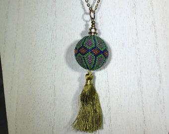 Swarovski Filigree Antique Gold- White Alabaster Bead with Large Glass Beaded Pendant and Light Green Tassel