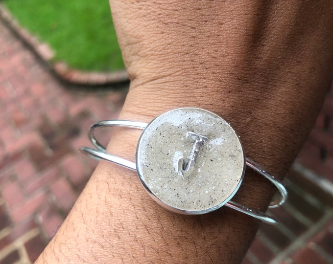 Silver plated initials in the sand from Clearwater beach theme bangle.