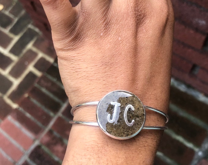 Silver plated initials in the sand from RIIS beach theme bangle.