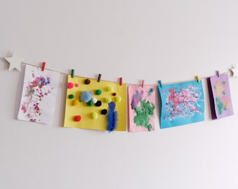 Childrens artwork display with white stars and colourful clothespegs, Easy fit kids paper craft hanger