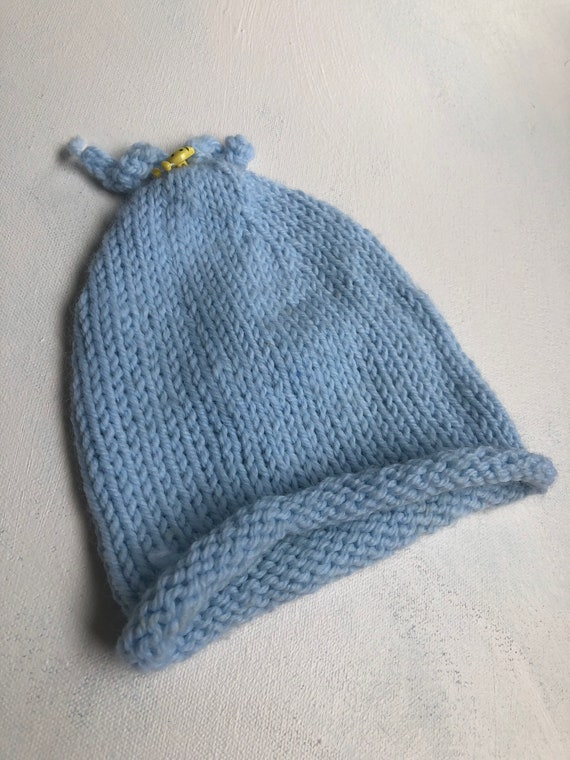 1089d1c4aa0 Vintage handmade knit blue beanie child size with yellow lady