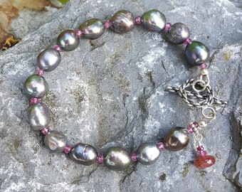 Handmade bracelet with peacock freshwater pearls and pink tourmaline, sterling silver jewelry