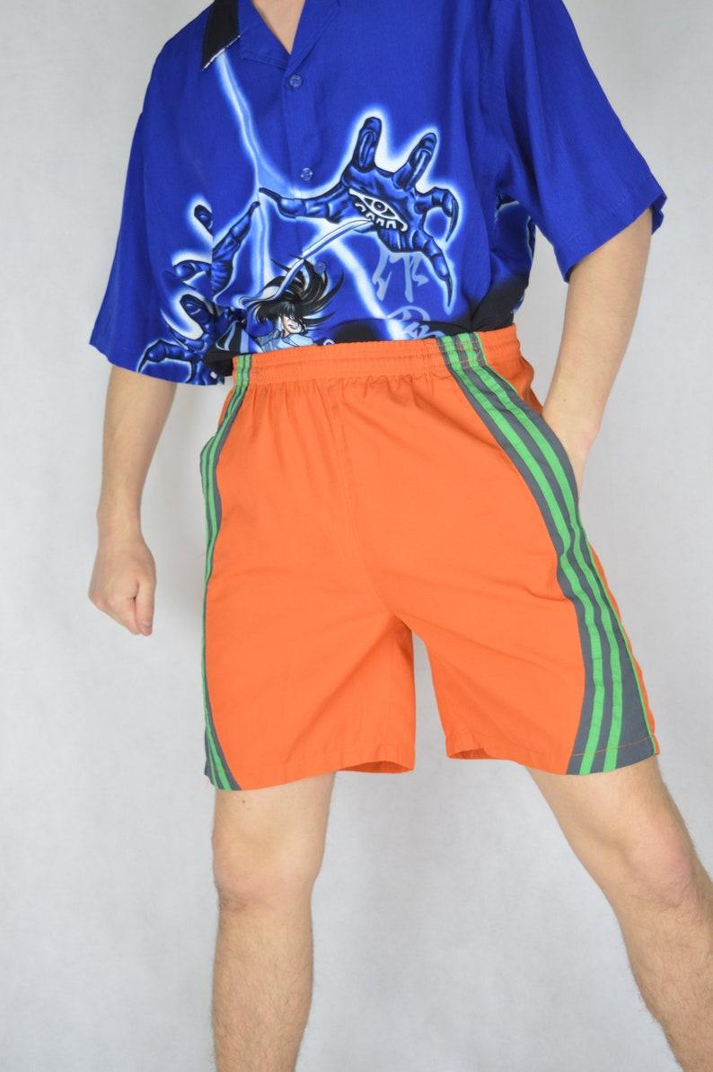 Vintage orange sports rave festival shorts