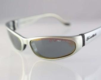 1c015c9f0d37 Vintage Bolle sport wraparound sunglasses, silver plastic frame, gray  polarized lenses, made in France