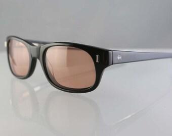 9eeff8f531 Vintage Stussy Michael lunettes de soleil cadre en plastique noir,  lentilles brun-jaune RARE