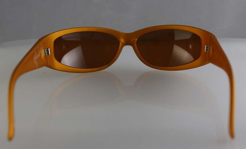 454625af7747c Vintage 90's Arnette Catfish wrap around sunglasses gold plastic frame,  brown lenses, made in Italy, surf skateboard style RARE