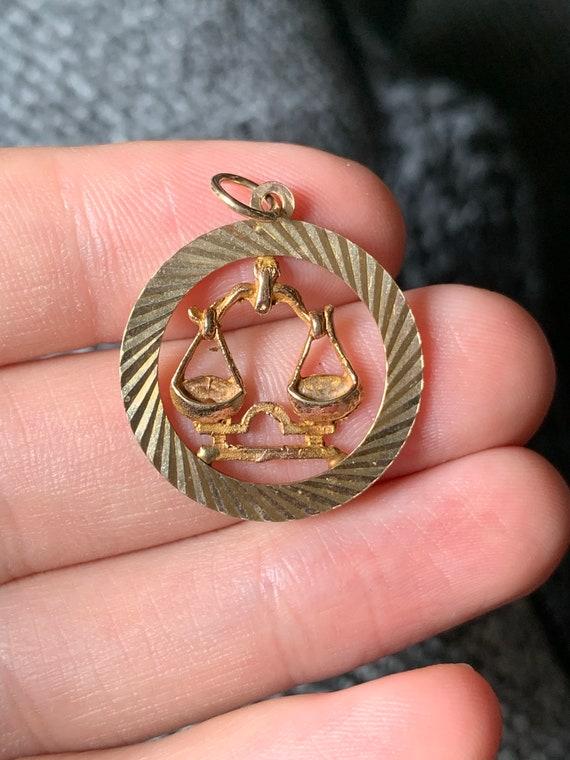 Sweet 9ct gold libra star sign pendant