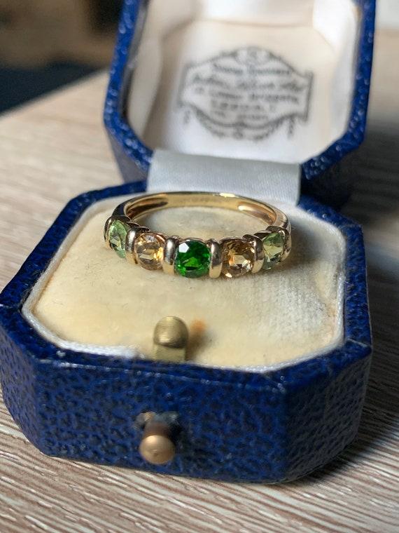 Beautiful 9ct gold multi gemstone ring