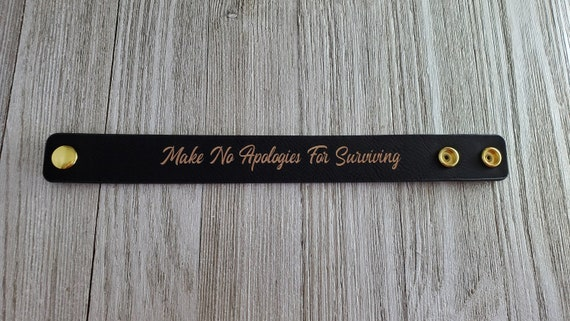 Make No Apologies Laser Engraved Leather Snap Cuff