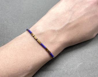 Custom Name Morse Code Bracelet beaded with gold and cobalt blue hematite gemstones
