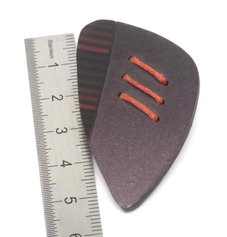 Plum irrisee red and black graphic pin