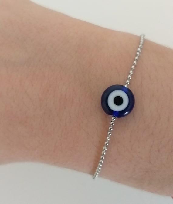 Pulsera ojo protector y cadena de acero