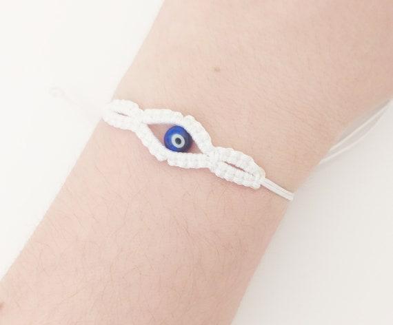 Pulsera protectora ojo turco hilo blanco