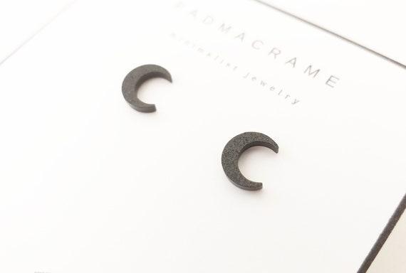 Par de pendientes de acero negro glitter