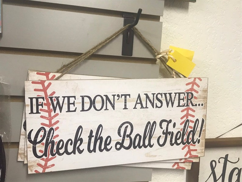 If We Don't Answer Check the Ball field Sign Baseball image 0