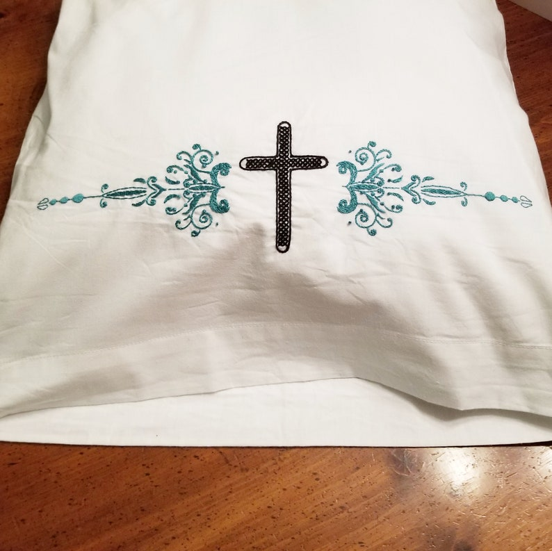 Cross and Floral Pillowcase Set in Teal and Black  Hand image 0