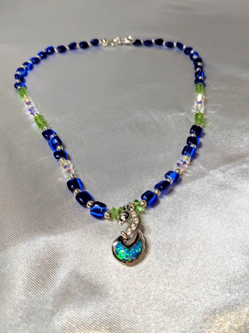 Elegant Sterling Silver swan pendant adorns this uniquely beaded necklace.