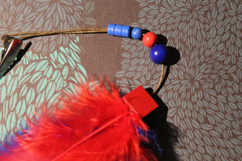 Hair clip fascinator red blue feather glitter cute magic Indian wizard enchants playful charm gift
