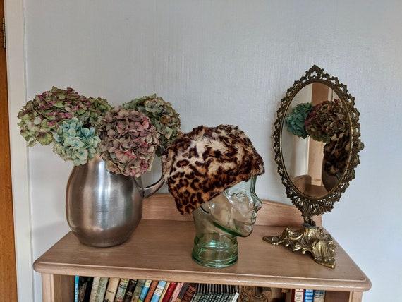 Stunning 1990s leopard print faux fur winter hat,