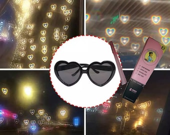 Black trippy heart sunglasses with a pack of pink cones look at the lights and see hearts free SaBEERnas Art stash bag