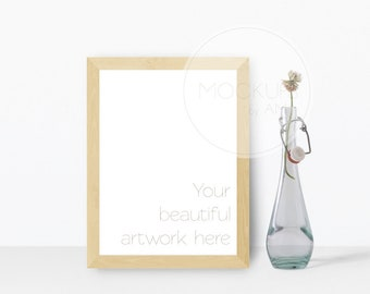 Download Free Frame mockup with elegant glass bottle PSD Template