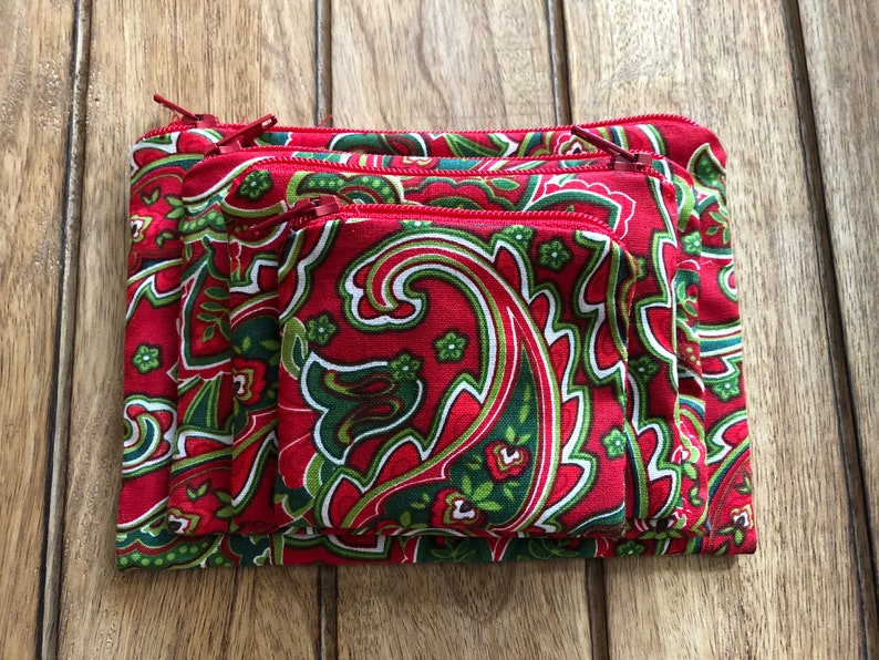 Holds Earbuds, Travel Items, Makeup, Change, Phone Chargers and more 4-Piece HOLIDAY PAISLEY Zippered Pouch Set