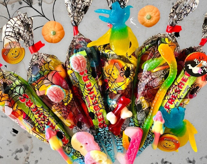 Personalised Halloween Sweet Cones, Filled Halloween party bags, Halloween table decorations. Spider web sweet cones. Dracula Teeth