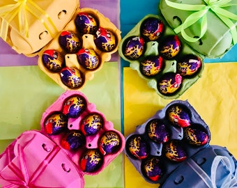 Creme Eggs In Egg Box Carton. Easter Chocolate Cream Eggs. Cadbury Creme Eggs Box. Wrapped in ribbon. Colourful Egg Gift Box  And Ribbon