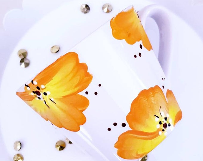 Featured listing image: Hand painted mug perfect for tea or coffee.  Hand painted with orange, yellow and white flowers.  You will have the prettiest mug around!