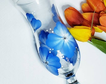 Pina Colada Glasses perfect for entertaining.  Blue and white flowers, black base.