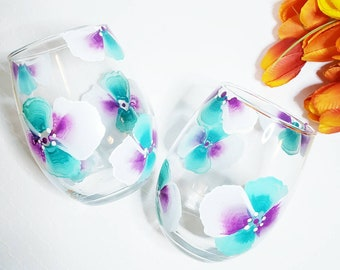 Hand painted stemless wine glasses with blue, magenta, and white pansies. These are perfect for special occasions, weddings, etc.