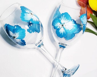 Handpainted large 15 oz. wine glasses with blue and white flowers.
