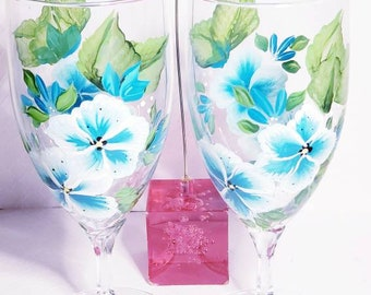 Hand painted wine glasses with blue and white flowers. These are perfect for special occasions, & weddings.