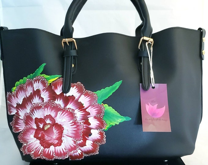 Featured listing image: Black handpainted Tote Bag with red & white flowers.  Comes with matching small purse and strap.  Store inside or use alone. Very versatile!