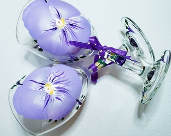 Hand painted wine glasses by Kindly Krafted Design with lavender and purple flowers.