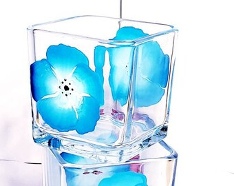 Beautiful hand glass candle holders with blue and white pansies.  Great for storing candles, candy, etc.