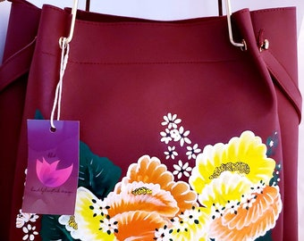 Red handpainted Handbag with custom floral design.  Comes with matching small purse and strap.  Store inside or use alone. Very versatile!