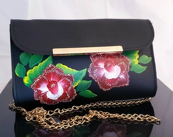 Black Clutch Bag with red & white flowers. Comes with removable gold chain strap perfect for casual or dressy outfits.