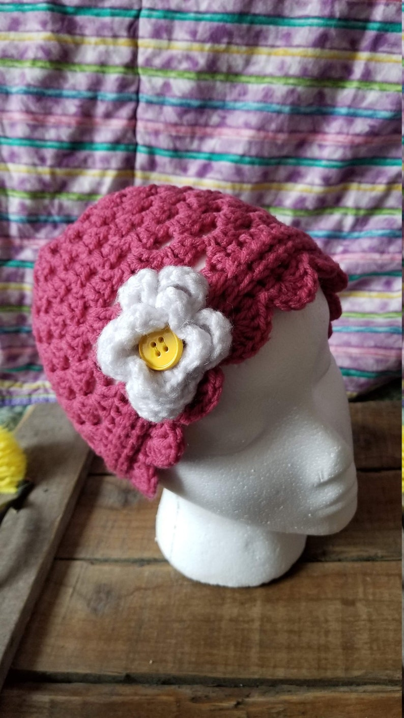 with white flower and yellow button Child sized pink winter hat beanie, skull cap