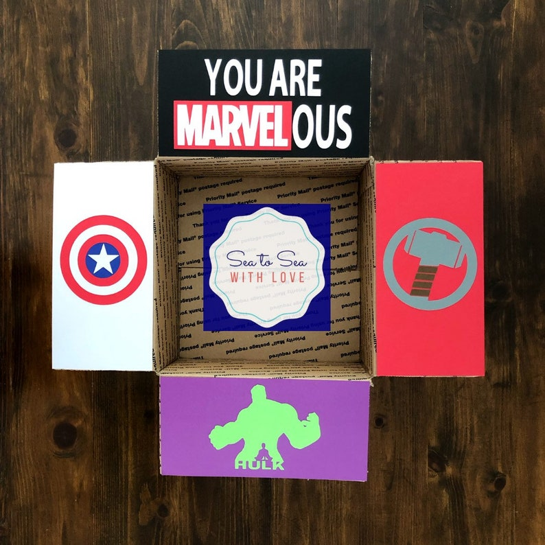 "inside of college care package decorated with superheroes and words that say, ""you are MARVELous"""