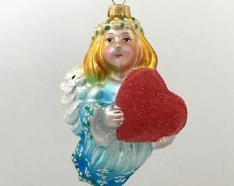 Little angel with a red heart