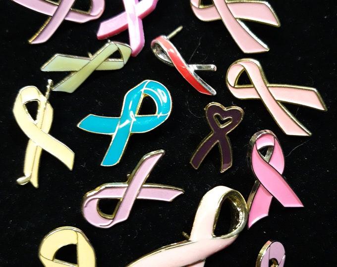 lot pink ribbon pin backs plus