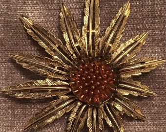 Signed Sarah Coventry starburst brooch